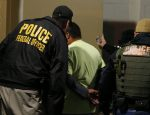 U.S. launches small-scale immigration raids as families hide
