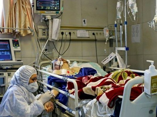 Iran says virus deaths drop below 100 for first time in month